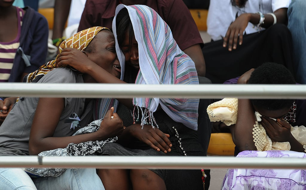 Women wept as they honored the lives lost in the 1994 slaughters.