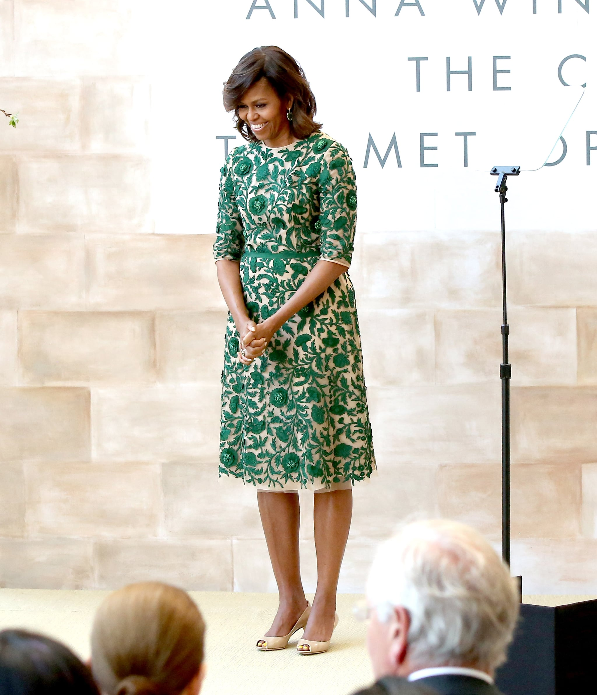 The first lady cut the ribbon at the Anna Wintour Costume Center Grand Opening in a custom floral-appliqué Naeem Khan dress.
