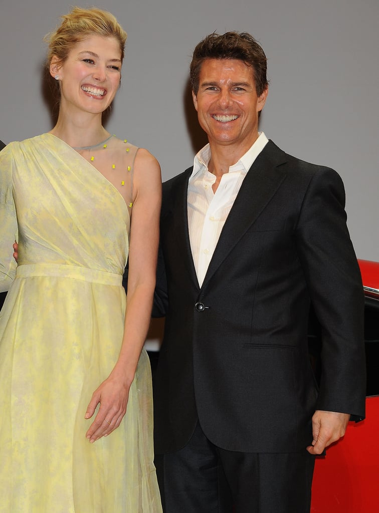 Tom Cruise laughed with Rosamund Pike.