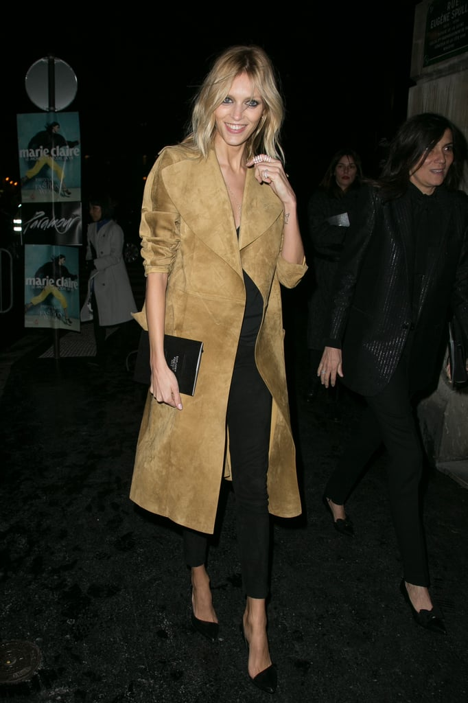 To catch a Paris fashion show, Anja Rubik picked a simple, sophisticated outfit, topping off an all-black outfit with a long suede coat.