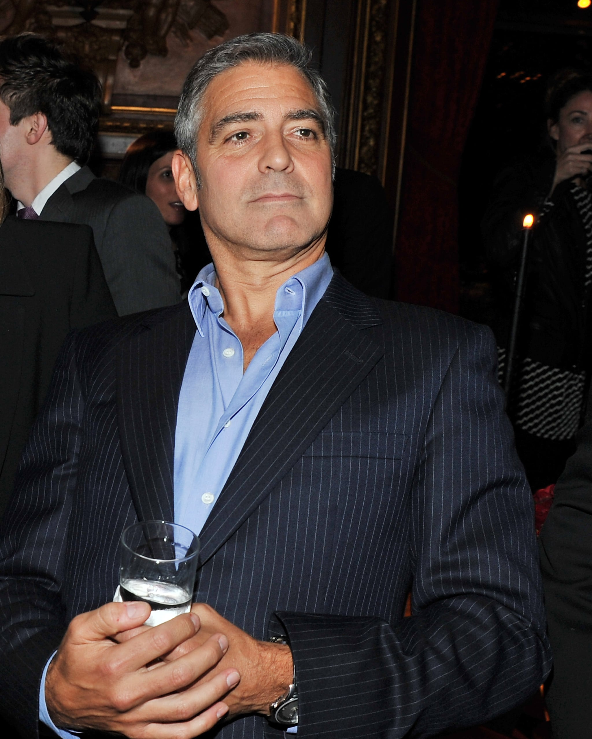 George Clooney surveyed the scene at The Ides of March afterparty in NYC.