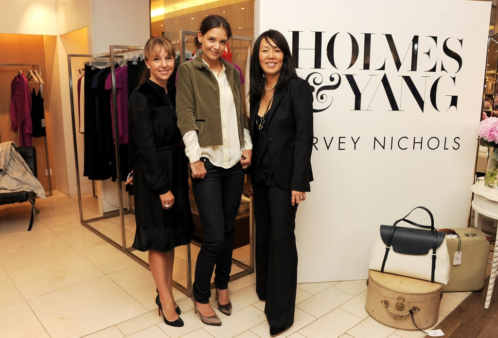 Katie Holmes posed with her Holmes & Yang clothing collection and bags.