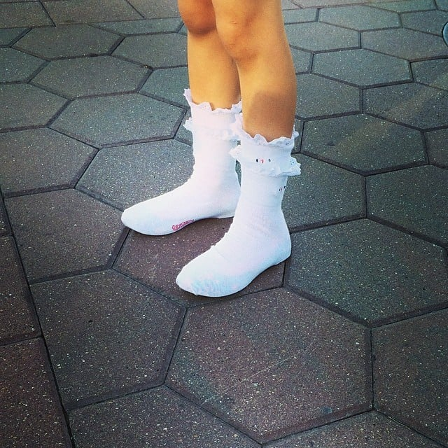 """Busy Philipps's daughter Birdie Silverstein took dressing in layers to a whole new level, wearing socks, shoes that were too big, and another pair of socks on top to """"keep them in place"""". Source: Instagram user busyphilipps"""