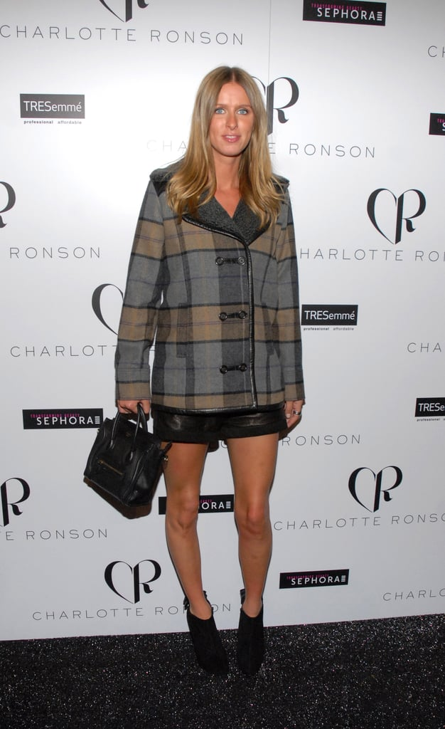 Nicky Hilton stepped out for Charlotte Ronson in a plaid coat and slick leather shorts.