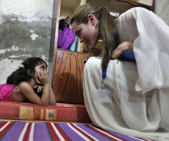 Slide Photo of Angelina Jolie Working With Child in Syria