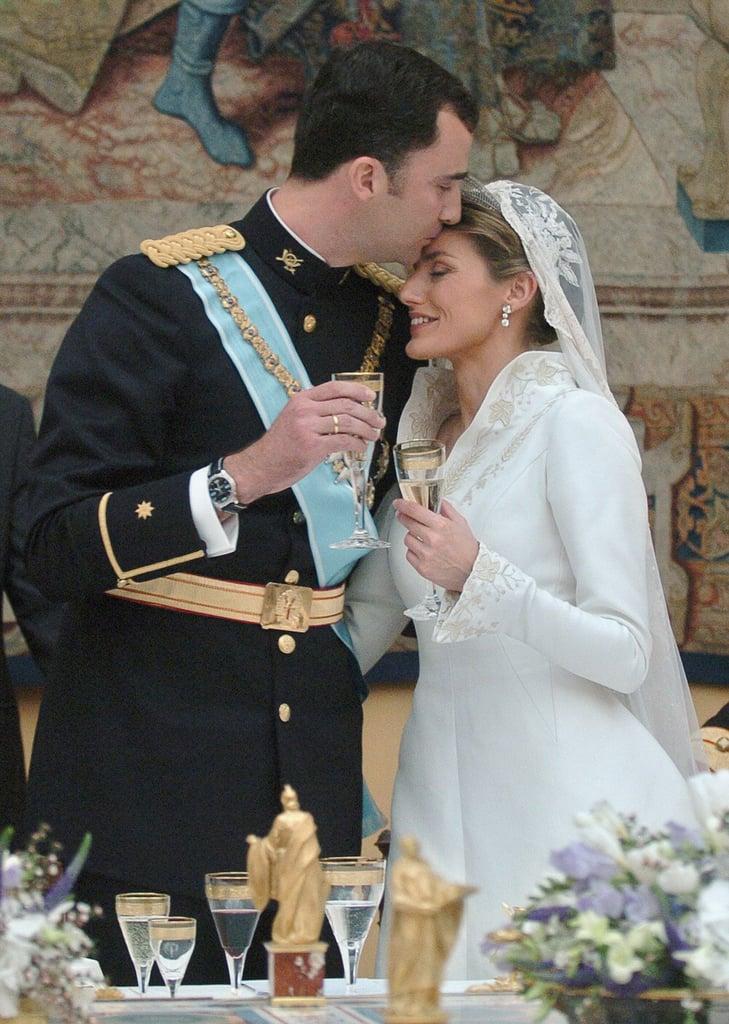 In May 2004, Felipe gave Letizia a tender kiss on their wedding day.