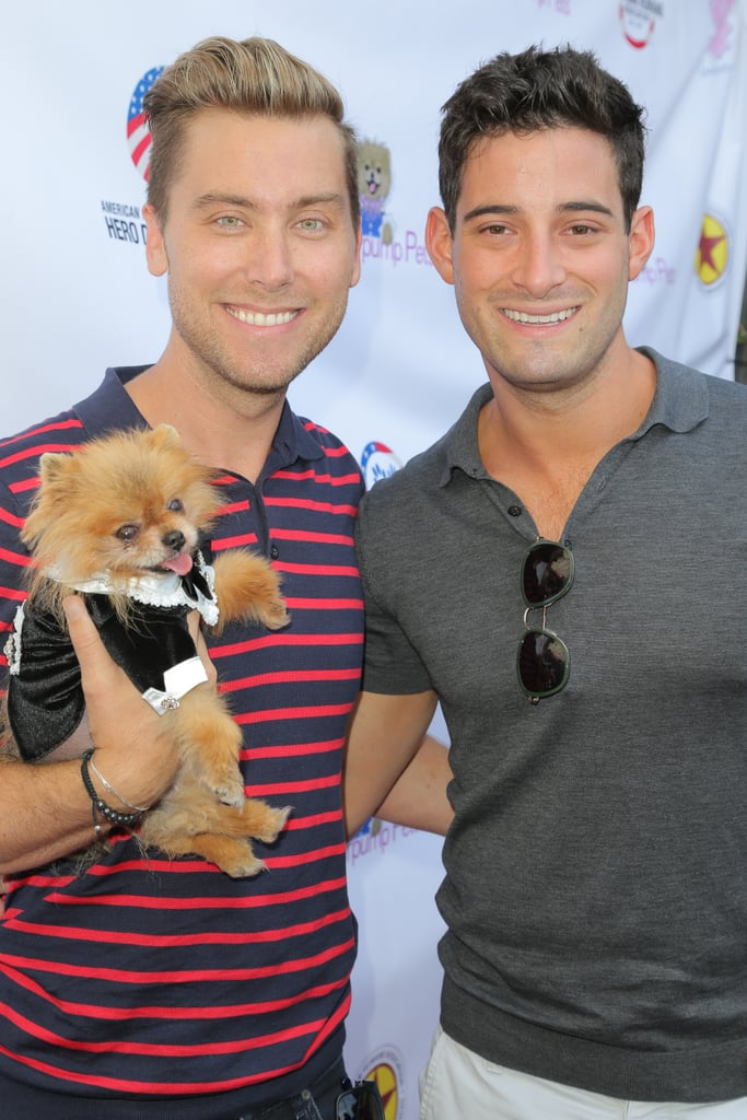 Lance Bass and Michael Turchin held onto Lisa Vanderpump's dog, Giggy, during an August 2015 event in LA.