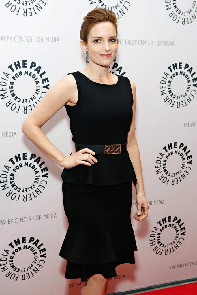 Tina Fey showed off her figure in a black belted dress in NYC.