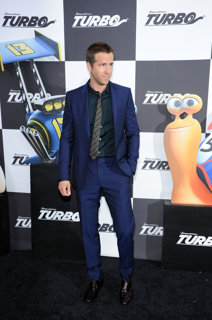 Ryan Reynolds wore a dark blue suit to the Turbo premiere on Tuesday.