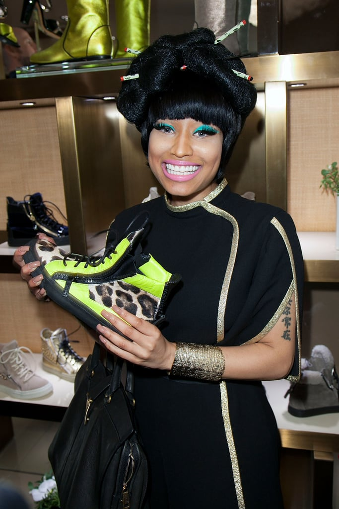 Nicki Minaj had fun checking out the Giuseppe Zanotti shoe display during the event in 2011.
