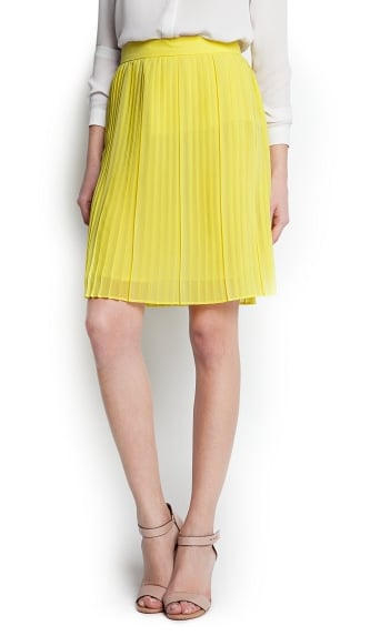 For a less structured skirt option, we adore this Mango yellow pleated skirt ($60). It's so dainty and would look great with blouses and tees alike.