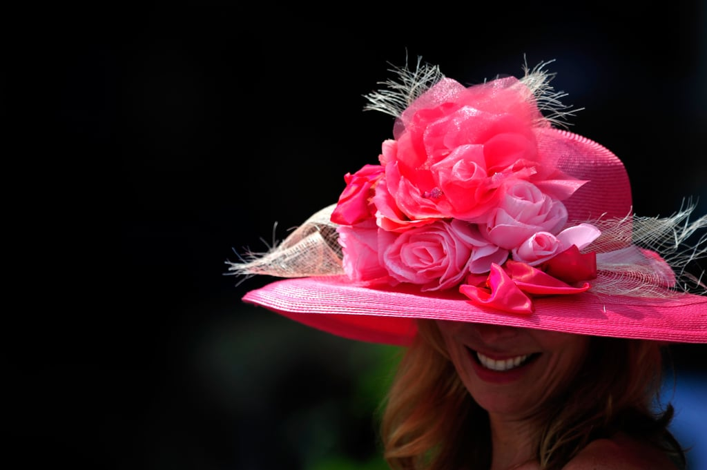 You could barely see this spectator under her pile of pink flowers in 2012.