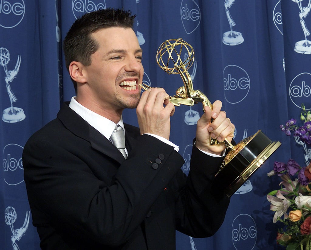 Sean Hayes chomped on his statue in 2000.