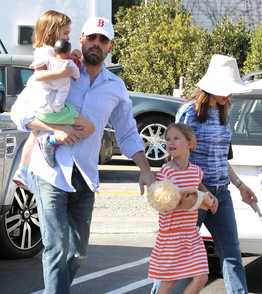 Ben Affleck held onto his girls, Violet and Seraphina, while out in LA at the Brentwood Country Mart on Saturday.
