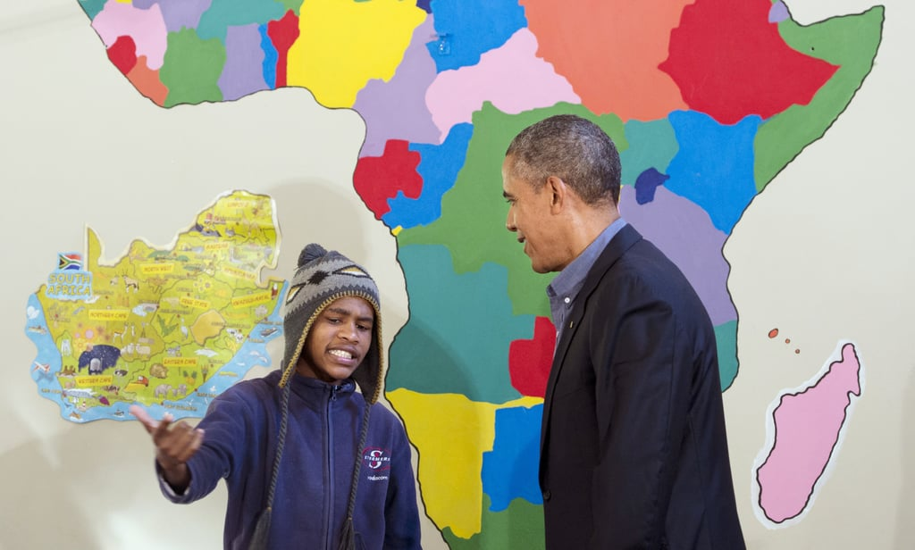 In June 2013, President Obama watched as a young boy rapped for him during a tour of the Desmond Tutu HIV Foundation Youth Center in Cape Town, South Africa.