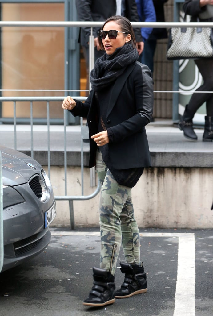 Alicia Keys sported her Isabel Marant sneakers with camouflage pants and a slick leather blazer while in Paris.