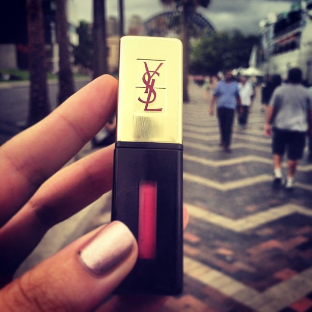 Alison absolutely loves her YSL Rouge Pur Couture Vernis a Levres — she says it's like a stain but when you lick your lips, it goes to a gloss!