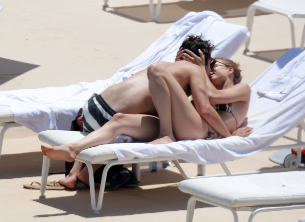 Emily VanCamp and Josh Bowman got hot and heavy by the pool during a June 2012 trip to Mexico.