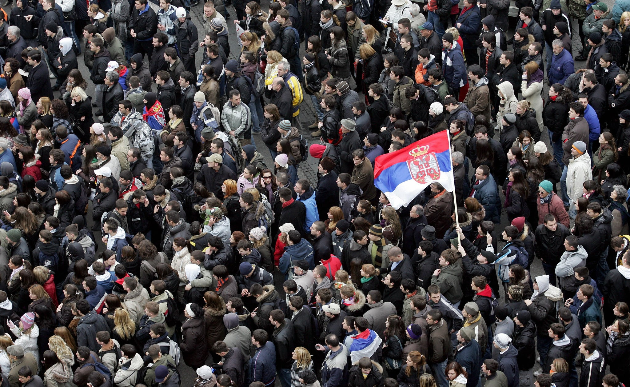 Serbian students wave flags during a peaceful protest in downtown Belgrade on February 18, 2008.