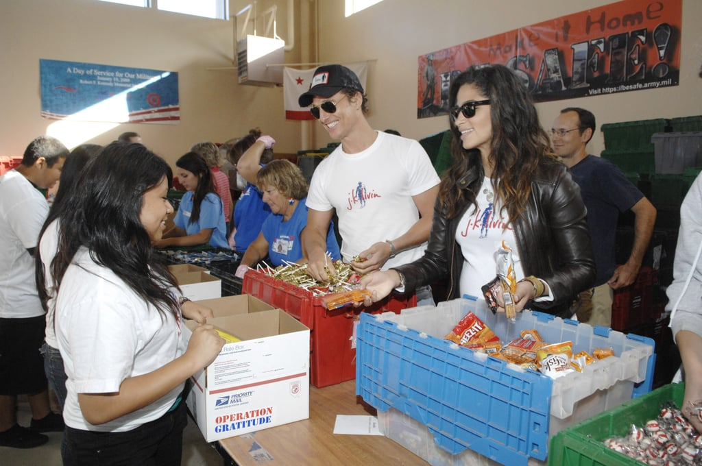 Matthew and Camila smiled while doing charity work at the Operation Gratitude event in LA in October 2009.