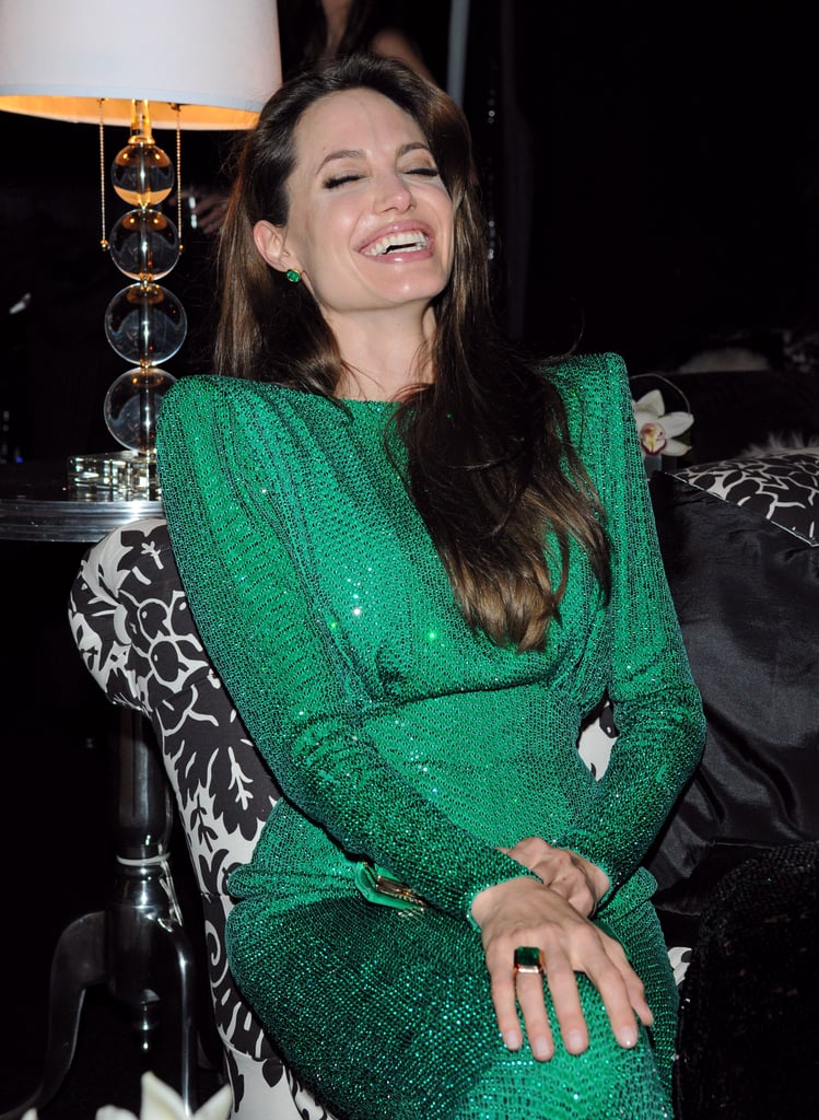 Angelina Jolie cracked herself up during the Sony afterparty in 2011.