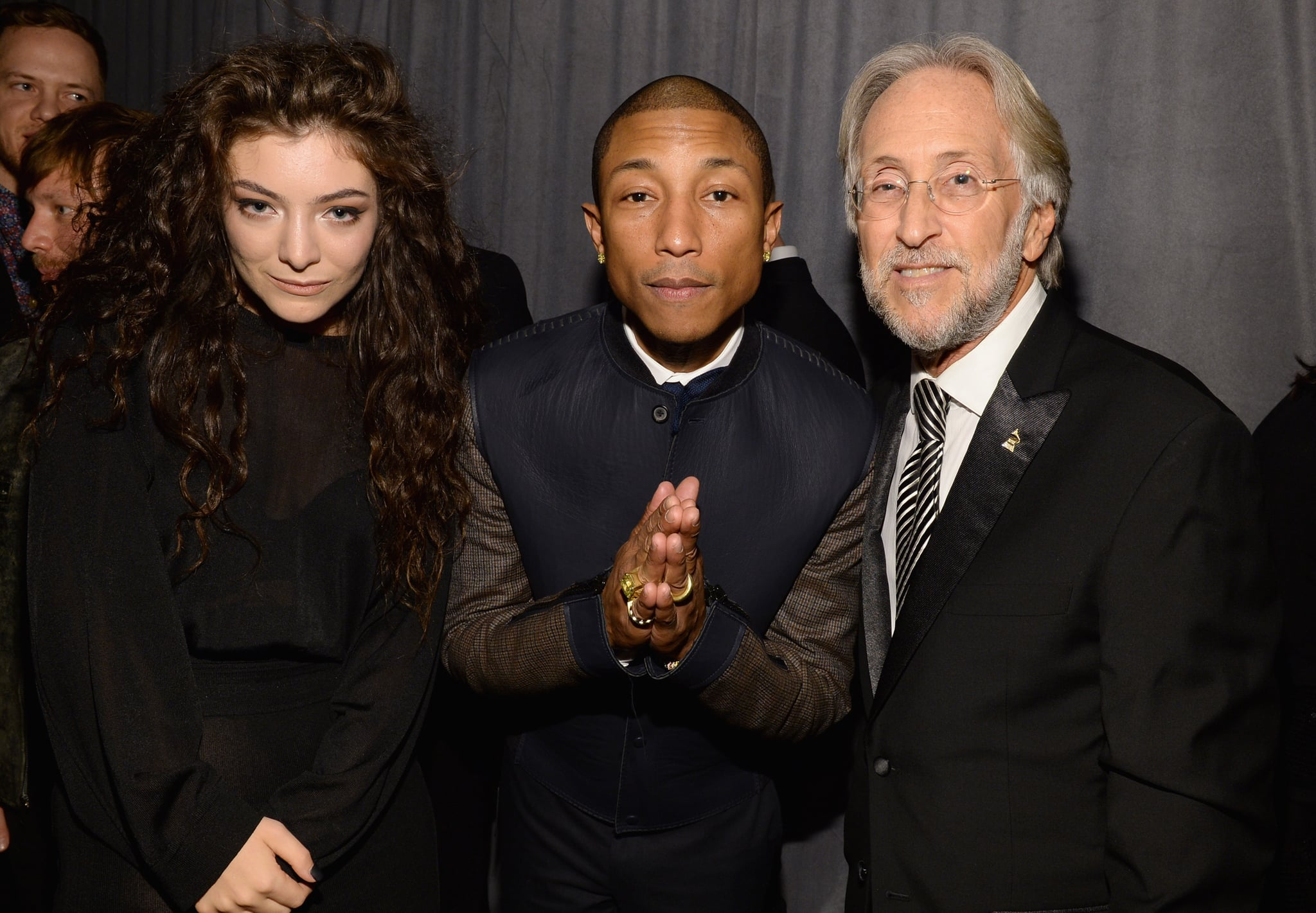 Lorde and Pharrell Williams gathered for a snap with Neil Portnow, CEO and president of the National Academy of Recording Arts and Sciences, who was honored at the party.