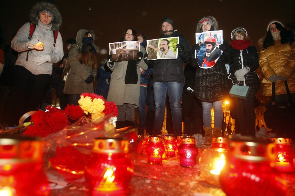 People held portraits of fallen protesters during a candlelight vigil.