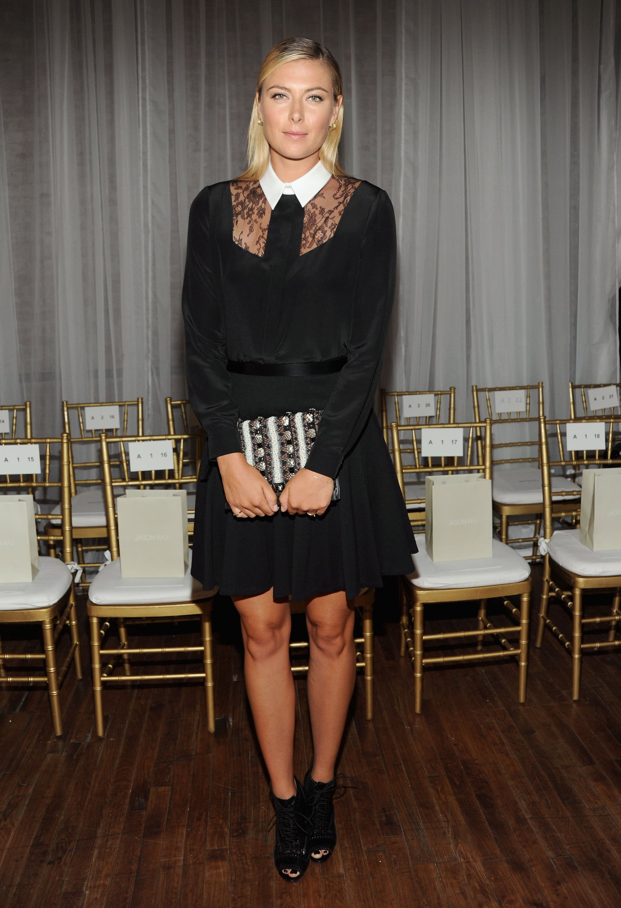 Maria Sharapova was chic in a black lace dress with a white collar at Jason Wu.