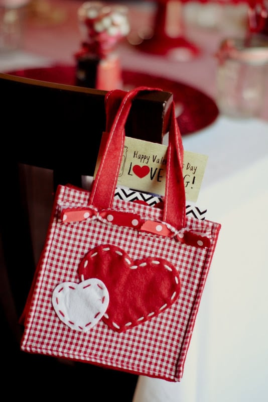 Guests took home cute, small, red-and-white heart bags as party gifts.  Source: Jenny Cookies
