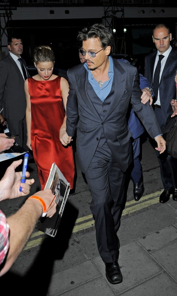 Johnny Depp and Amber Heard held hands for a date night in London.