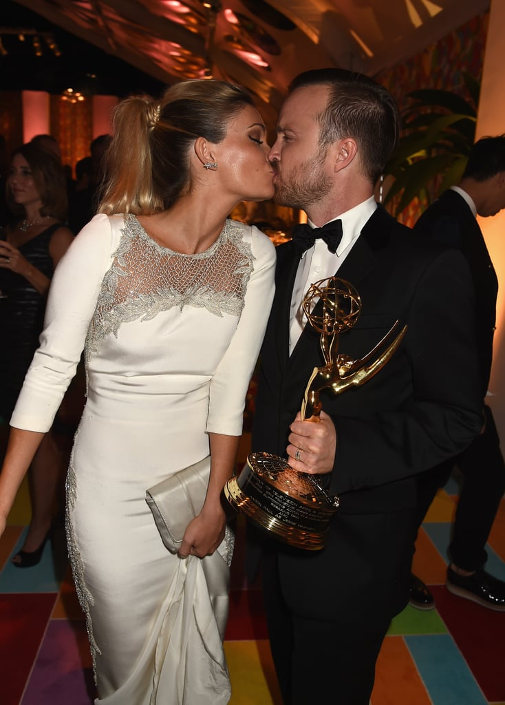Aaron Paul kissed his wife, Lauren, after his big win.