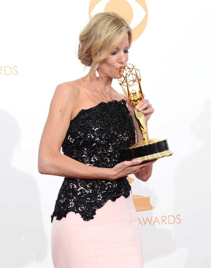 Anna Gunn puckered up to her Emmy.