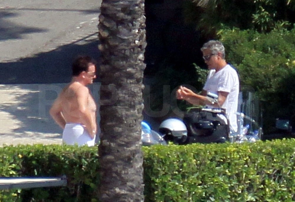 George Clooney and Bono talked outside.