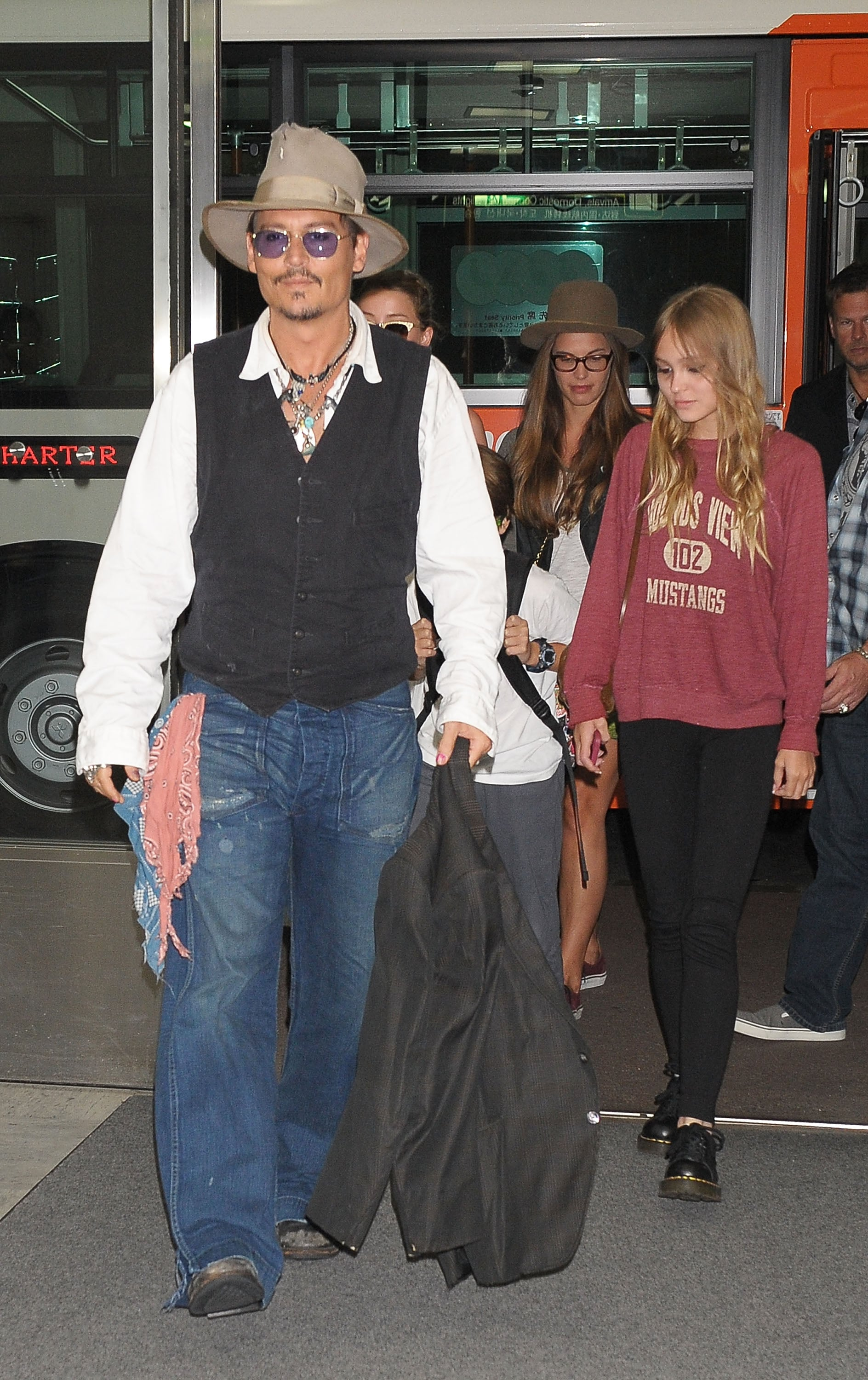 Johnny Depp and his kids walked through the airport.