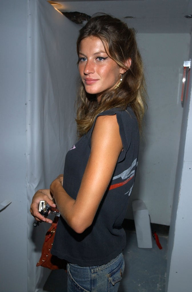 A young Gisele Bundchen was dressed down in a t-shirt and jeans for the Marc Jacobs September 2002 show afterparty.