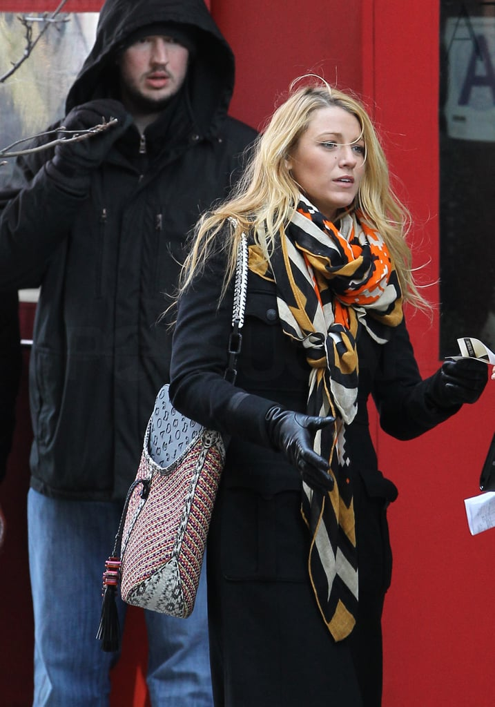 Blake Lively in a black coat on the set of Gossip Girl in NYC.