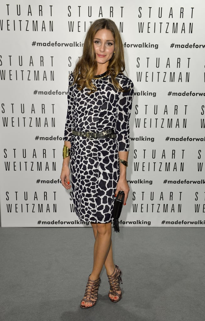 Olivia Palermo dressed up in a black-and-white animal-print number and caged sandals at the Stuart Weitzman store opening during Milan Fashion Week.