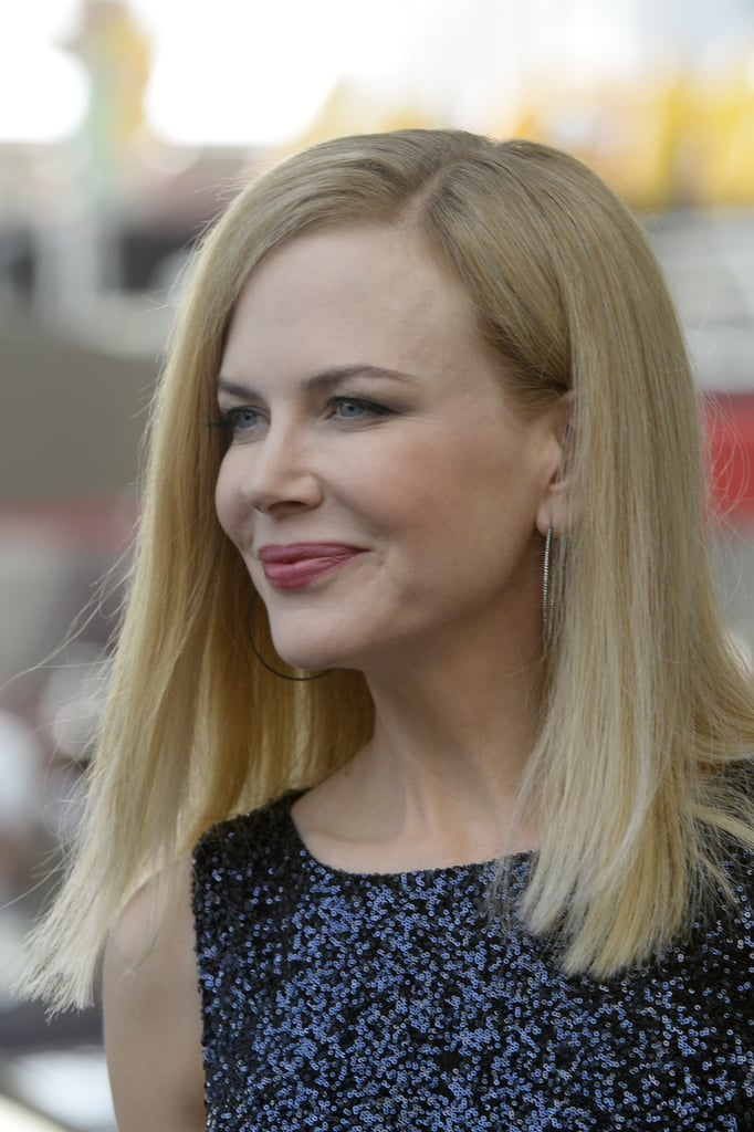 As a judge at the Cannes Festival this year, Nicole Kidman will be showing plenty of face. For her first photocall, the actress opted for a casual blowout, glowing skin, and a pretty pink lip hue.