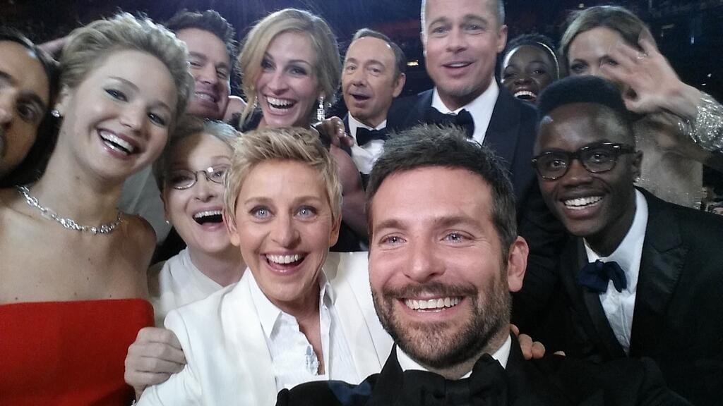 Jennifer Lawrence, Bradley Cooper, Brad Pitt, Julia Roberts, Ellen DeGeneres, and more squeezed in for a selfie during the Oscars.  Source: Twitter user TheEllenShow