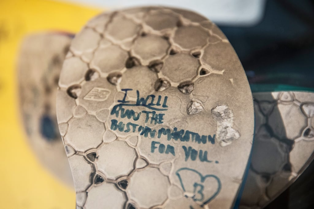 "One of the shoes on display read, ""I will run the Boston Marathon for you."""