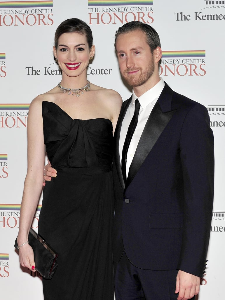 Anne Hathaway stayed close to fiancé Adam Shulman in DC.