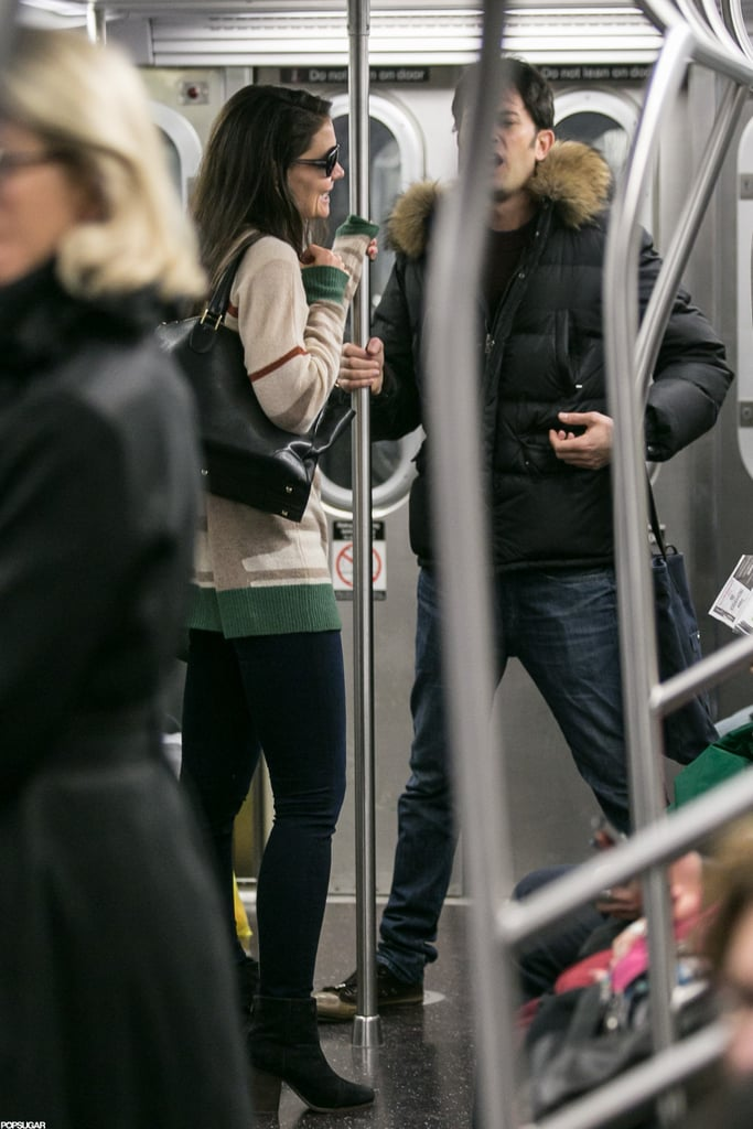 Katie Holmes commuted to her show on the subway accompanied by a male companion.