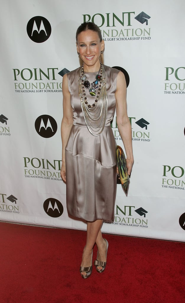 Parker took her polished champagne look  — Yves Saint Laurent dress and matching peep-toe pumps — to new heights via layers of statement necklaces and a multicolor snake clutch during an April 2008 event in NYC.