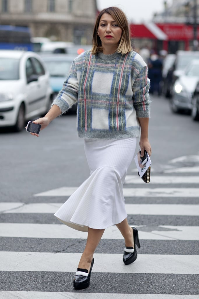 A little plaid action to counter a white skirt.