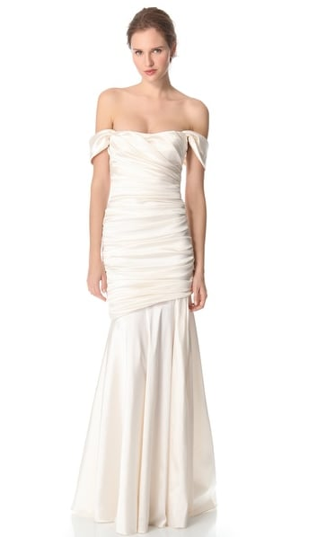 We love how the sleeves on this Theia off-the-shoulder gown ($995) fall ever-so effortlessly. Subtly sexy.