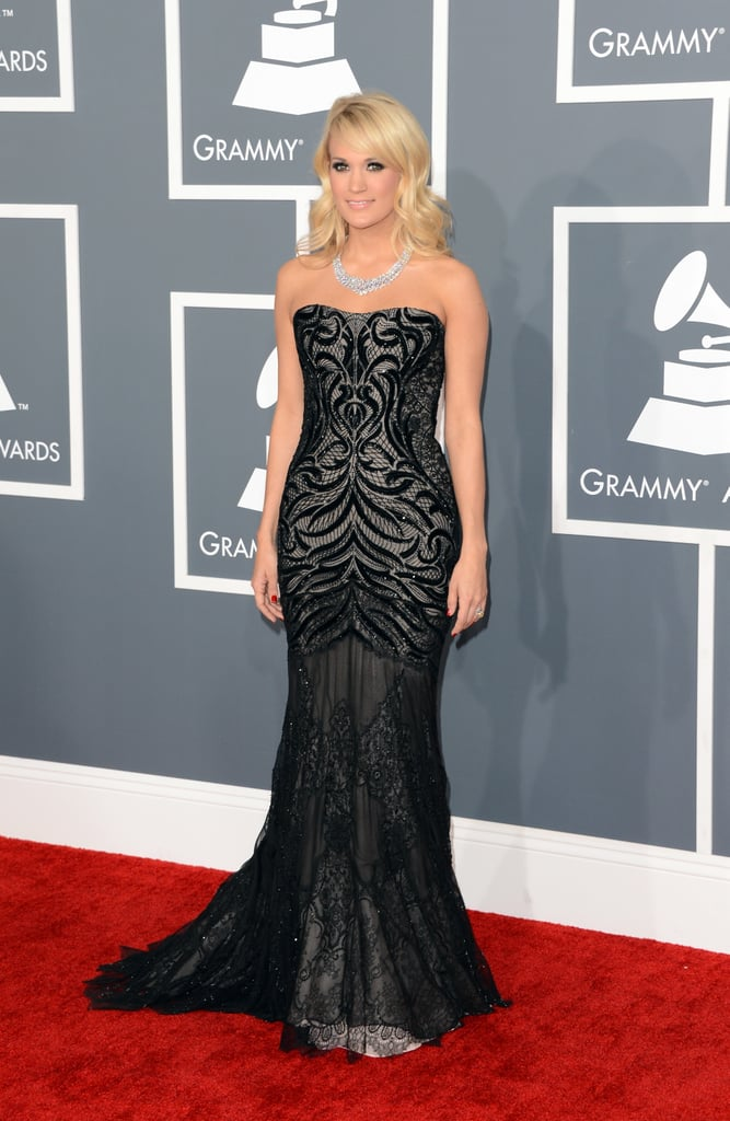 Before her Grammys performance, Carrie Underwood took to the red carpet in a Roberto Cavalli gown.