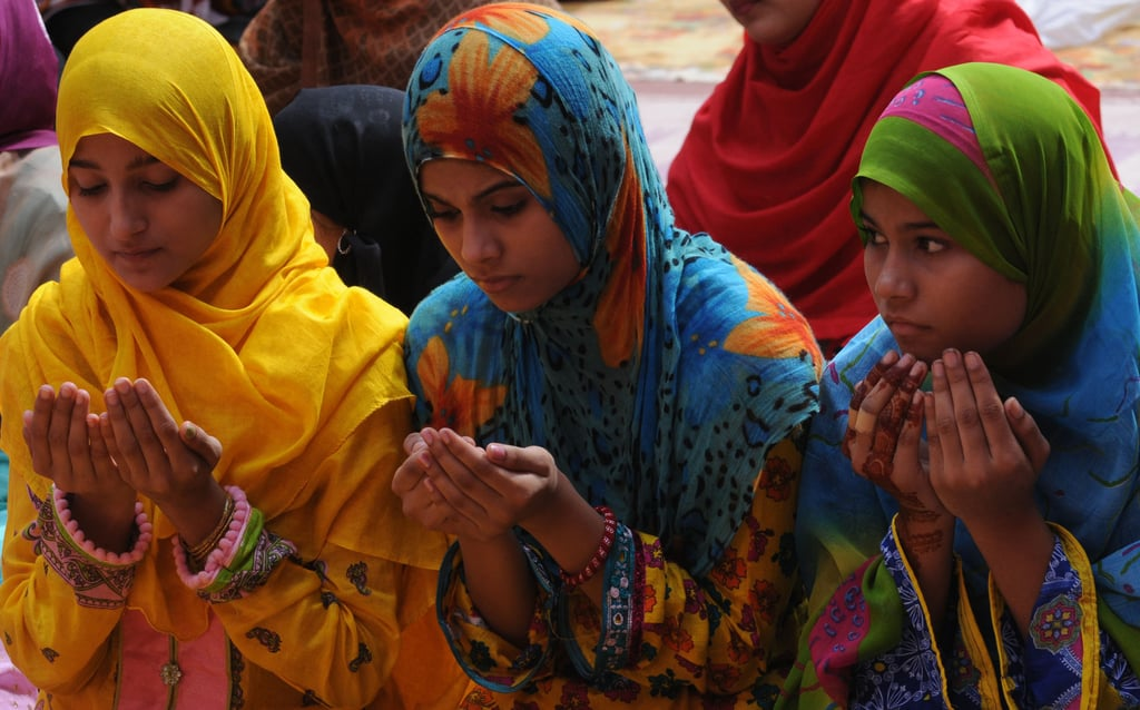 Women in Pakistan prayed during the Eid al-Fitr prayers in Lahore.