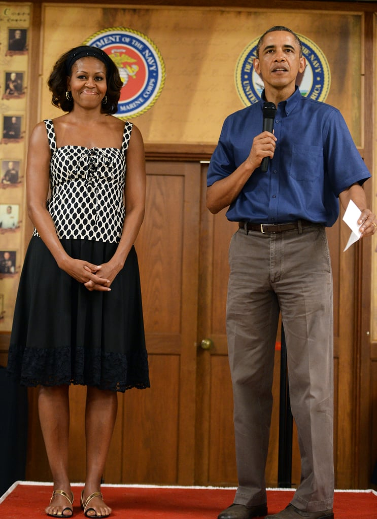 Michelle took the black and white trend for a spin, styling a geometric-print top with a lace-trim skirt and metallic sandals, while chatting with Marine Corps in Hawaii on Christmas Day 2013.
