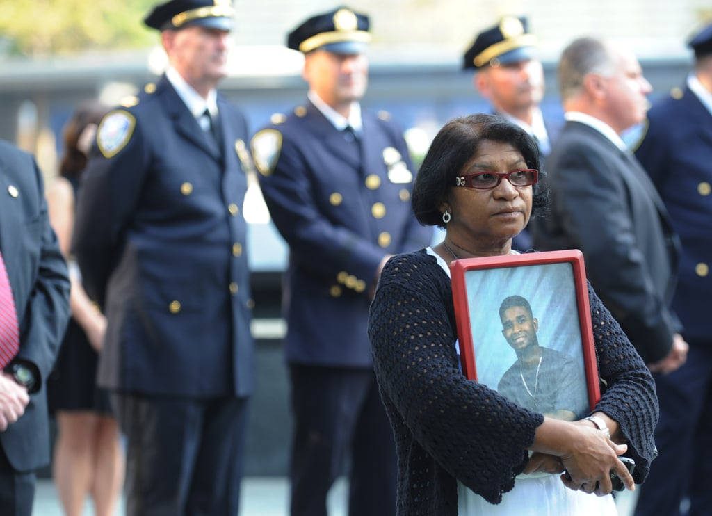 A woman held onto a picture at the 9/11 Memorial during commemoration ceremonies in NYC.