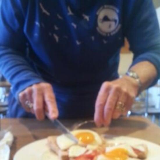 Woman Cuts Food For Breastfeeding Mom